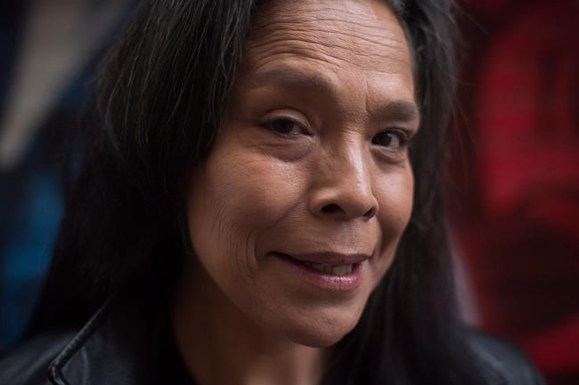 "Maggy Gisle laughs while standing for a photograph in the Downtown East Side of Vancouver, B.C., on Tuesday May 9, 2017. Gisle fought for two decades for the inquiry into missing and murdered Indigenous women and girls but she says the current commission isn't giving her much to cling to.Gisle, an abuse victim, former addict and sex worker who spent 16 years on the Downtown East Side, said Friday she was shocked to find out through the media that the inquiry lost a second executive director, adding its communication ""really sucks.""THE CANADIAN PRESS/Darryl Dyck"