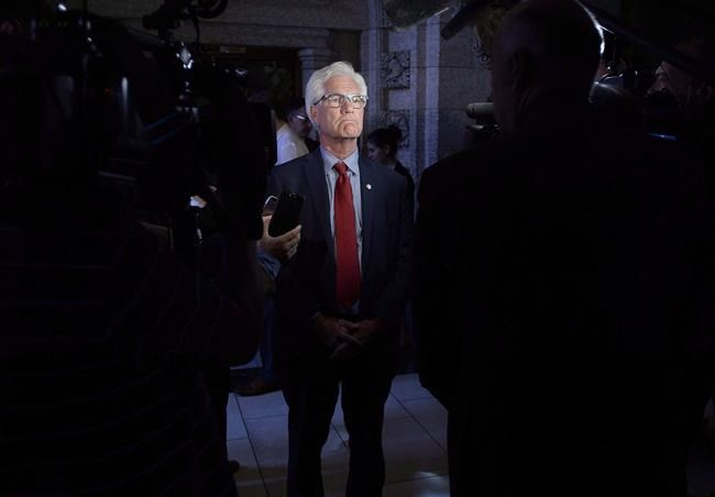 Minister of Natural Resources Jim Carr speaks to reporters following Question Period in the House of Commons on Parliament Hill in Ottawa on Tuesday, May 29, 2018. The federal government has taken a step towards fulfilling it's promise to get rid of fossil fuel subsidies by agreeing to finally explain how much it actually spends on them. THE CANADIAN PRESS/Justin Tang
