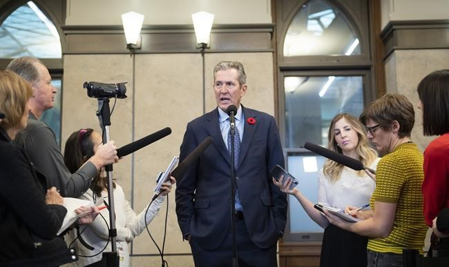 The Manitoba government is taking out newspaper and electronic advertisements in Quebec that welcome civil servants to move to Manitoba if they feel threatened by Quebec's ban on religious symbols in the workplace. Manitoba Premier Brian Pallister speaks to reporters after meeting with Prime Minister Justin Trudeau, not shown, on Parliament Hill in Ottawa, Friday, Nov. 8, 2019. THE CANADIAN PRESS/Justin Tang