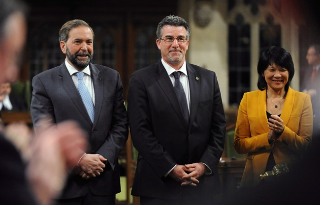 New;y-elected NDP MP Craig Scott is applauded as he is presented to the House of Commons by NDP Leader Tom Mulcair and MP Olivia Chow on Parliament Hill in Ottawa on Thursday, March 29, 2012. Former Toronto MP Craig Scott says the Leap Manifesto, which is being embraced by more than a dozen NDP riding associations ahead of the party's April convention, should serve as a reference point for future policy discussions.THE CANADIAN PRESS/Sean Kilpatrick