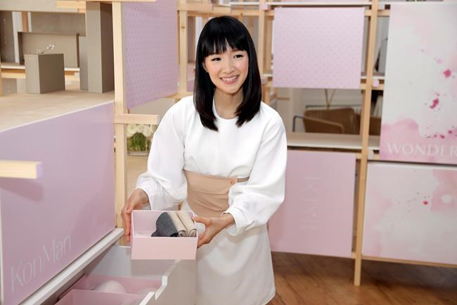 Japanese organizational expert Marie Kondo introduces her new line of storage boxes during a media event in New York on July 11, 2018. Are the volumes crowding your bookshelves classics or clutter? It's a question raised by tidying guru Marie Kondo that's spurred bibliophilic uproar online. THE CANADIAN PRESS/AP, Seth Wenig