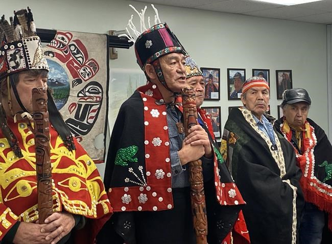Na'moks (centre), a spokesman for the Wet'suwet'en hereditary chiefs, holds a press conference in Smithers, B.C., Tuesday, Jan.7, 2020, on the one-year anniversary of RCMP enforcement of an injunction granted to Coastal GasLink. Hereditary chiefs of the Wet'suwet'en Nation are pledging to continue fighting a natural gas pipeline through their traditional territory, days after 28 of their supporters were arrested for blocking access to a work site in northern British Columbia. THE CANADIAN PRESS/Amy Smart