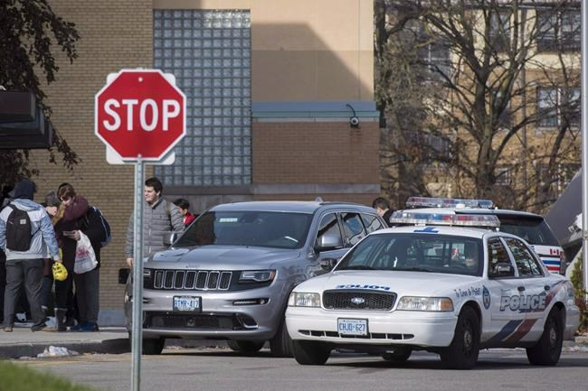 Toronto police respond to a bomb threat at St. Michael's College School, in Toronto on Monday, Nov. 19, 2018. It's been called a rite of passage, a bonding ritual, a way to initiate novice members into a fraternity, elite sports team or military unit through physical and mental challenges ??? with the aim of individuals becoming cemented into the whole. THE CANADIAN PRESS/ Tijana Martin