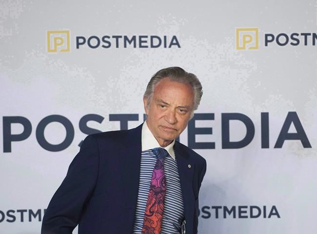 Postmedia CEO Paul Godfrey speaks during the company's annual general meeting in Toronto on Thursday, January 12, 2017. Postmedia Network Inc. says four Ontario newspapers will publish printed or digital editions one less day of the week with no reduction in the subscription price.THE CANADIAN PRESS/Nathan Denette