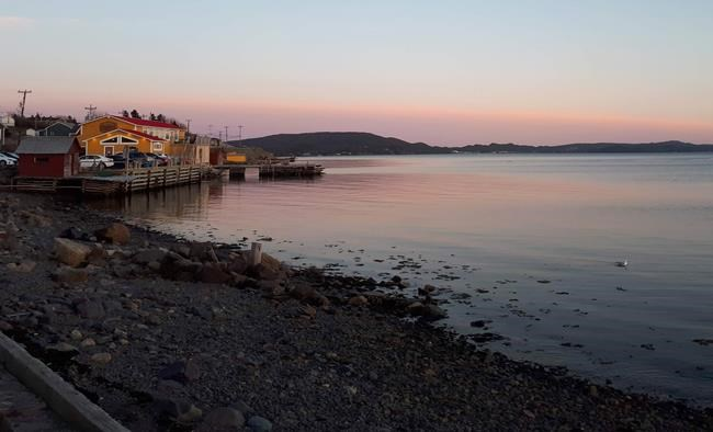 The sun sets on Didlo, Newfoundland on May 25, 2019. The picturesque Newfoundland community of Dildo is taking in unprecedented international attention over its name, as late night comedian Jimmy Kimmel continues his televised quest to become its mayor. THE CANADIAN PRESS/Holly McKenzie-Sutter