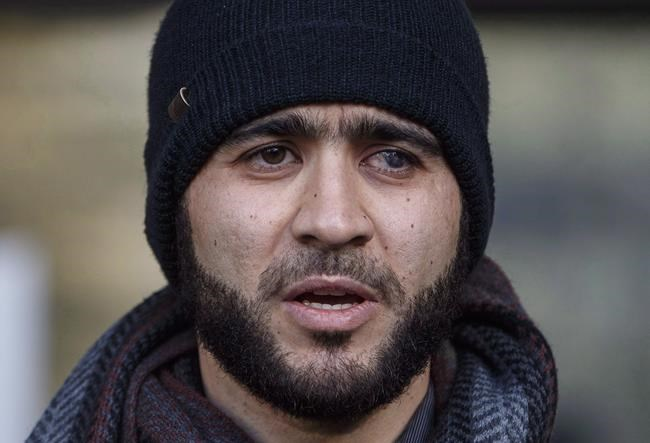 Omar Khadr speaks outside court in Edmonton on Thursday, December 13, 2018. An Alberta judge is expected to rule today on whether a war crimes sentence for former Guantanamo Bay prisoner Khadr should be declared expired.THE CANADIAN PRESS/Jason Franson