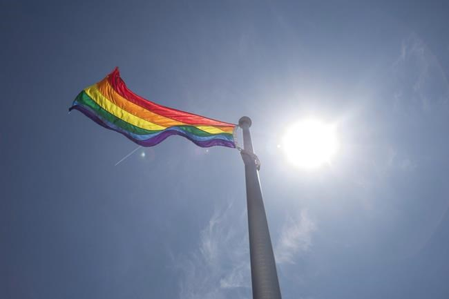 A rainbow flag flies at Toronto City Hall in Toronto on Tuesday, May 31, 2016. A lawyer says some victims of the federal government's gay purge were so devastated by the experience that even decades later they needed the help of a therapist to fill out forms to receive financial compensation. THE CANADIAN PRESS/Eduardo Lima