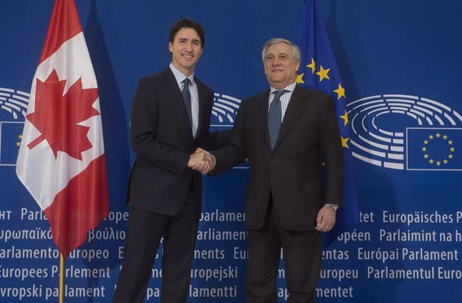 Lawmakers in France begin the ratification of the comprehensive trade agreement between the European Union and Canada as Prime Minister Justin Trudeau welcomes the leaders of the 28-country bloc to Montreal on Wednesday. Canadian Prime Minister Justin Trudeau is greeted by the President of the European Parliament Antonio Tajani as he arrives at the European Parliament in Strasbourg, France, Thursday, Feb. 16, 2017. THE CANADIAN PRESS/Adrian Wyld