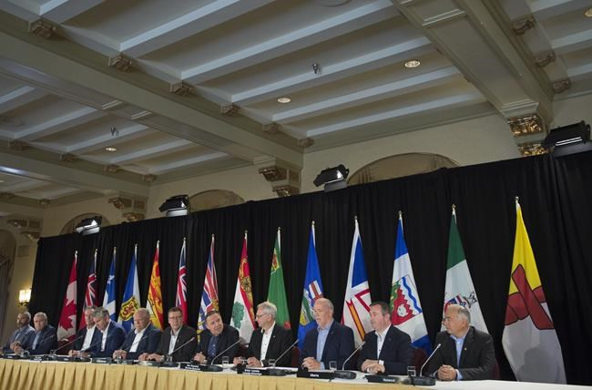 Canada's Premiers, left to right, Sandy Silver, Yukon, Dwight Ball, Newfoundland and Labrador, Brian Pallister, Manitoba, Stephen McNeil, Nova Scotia, Doug Ford, Ontario, Scott Moe, Saskatchewan, Francois Legault, Quebec, Blaine Higgs, New Brunswick, John Horgan, British Columbia, Jason Kenney, Alberta and Joe Savikataaq, Nunavut are seen during a closing news conference following a meeting of Canada's Premiers in Saskatoon, Sask. Thursday, July 11, 2019. Canada's premiers are meeting today just outside Toronto for the first time as a group since the federal election. THE CANADIAN PRESS/Jonathan Hayward