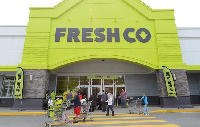 People enter a FreshCo store in Mission, B.C. on Thursday, April 25, 2019. Worrying about being infected with COVID-19 at the grocery store where she works has become part of the job for Kelly Ferguson, who lives with her 90-year-old mother. THE CANADIAN PRESS/Jonathan Hayward