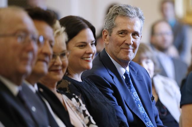 Premier Brian Pallister looks at some of his new provincial MLAs who were sworn into the Manitoba legislature in Winnipeg on September 25, 2019. Manitoba politicians are returning to the legislature for the first time since the provincial election three weeks ago. Premier Brian Pallister has said a short throne speech laying out his priorities will start the abbreviated, two-week session. THE CANADIAN PRESS/John Woods