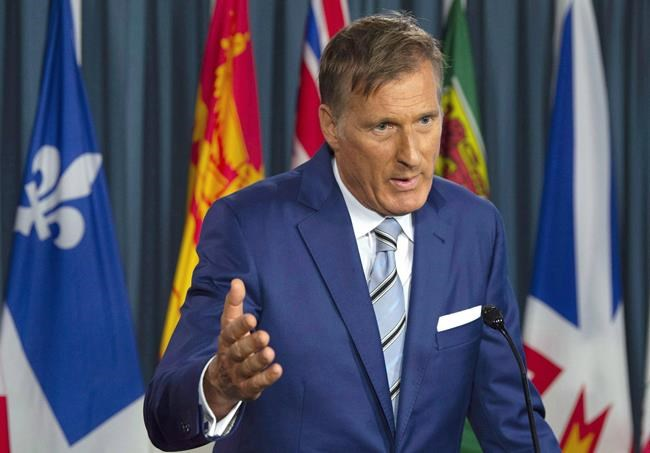 Maxime Bernier responds to questions after announcing he will leave the Conservative party during a news conference in Ottawa, Thursday August 23, 2018. While maverick MP Bernier may not have caucus support for his political party, he has attracted an eclectic group of people to his cause. THE CANADIAN PRESS/Adrian Wyld