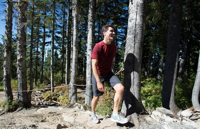 Liberal Leader Justin Trudeau climbs the famous Grouse Grind during an election campaign stop in North Vancouver, B.C., Friday, September 11, 2015. THE CANADIAN PRESS/Jonathan Hayward
