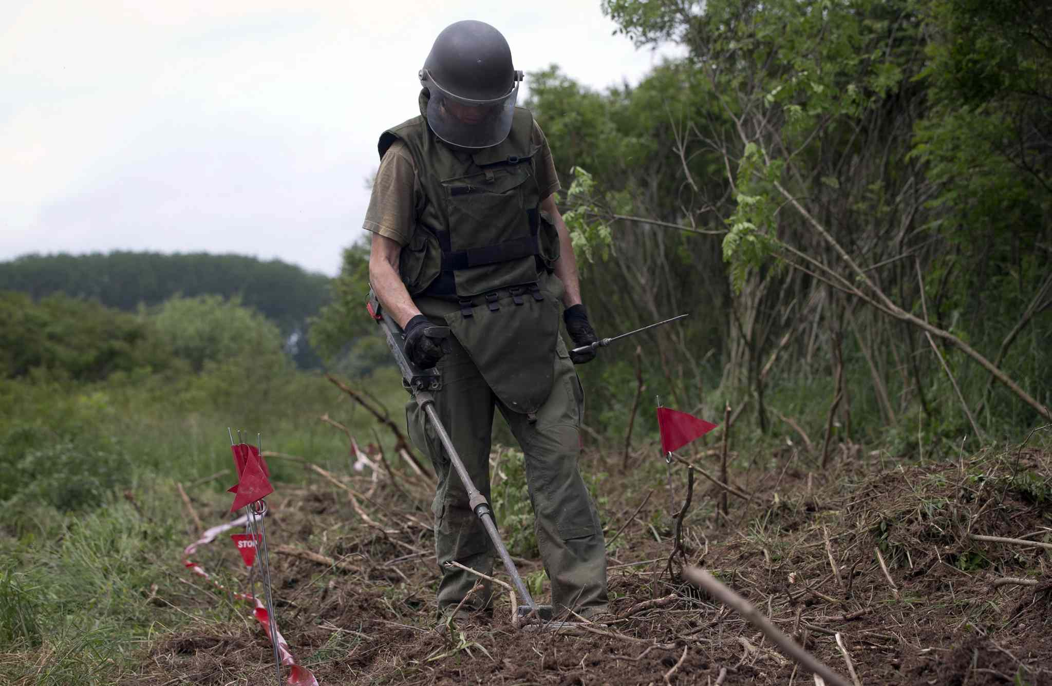 Ante Ivanda, a de-miner, searches for land mines in Petrinja, central Croatia, Friday, May 17, 2013.