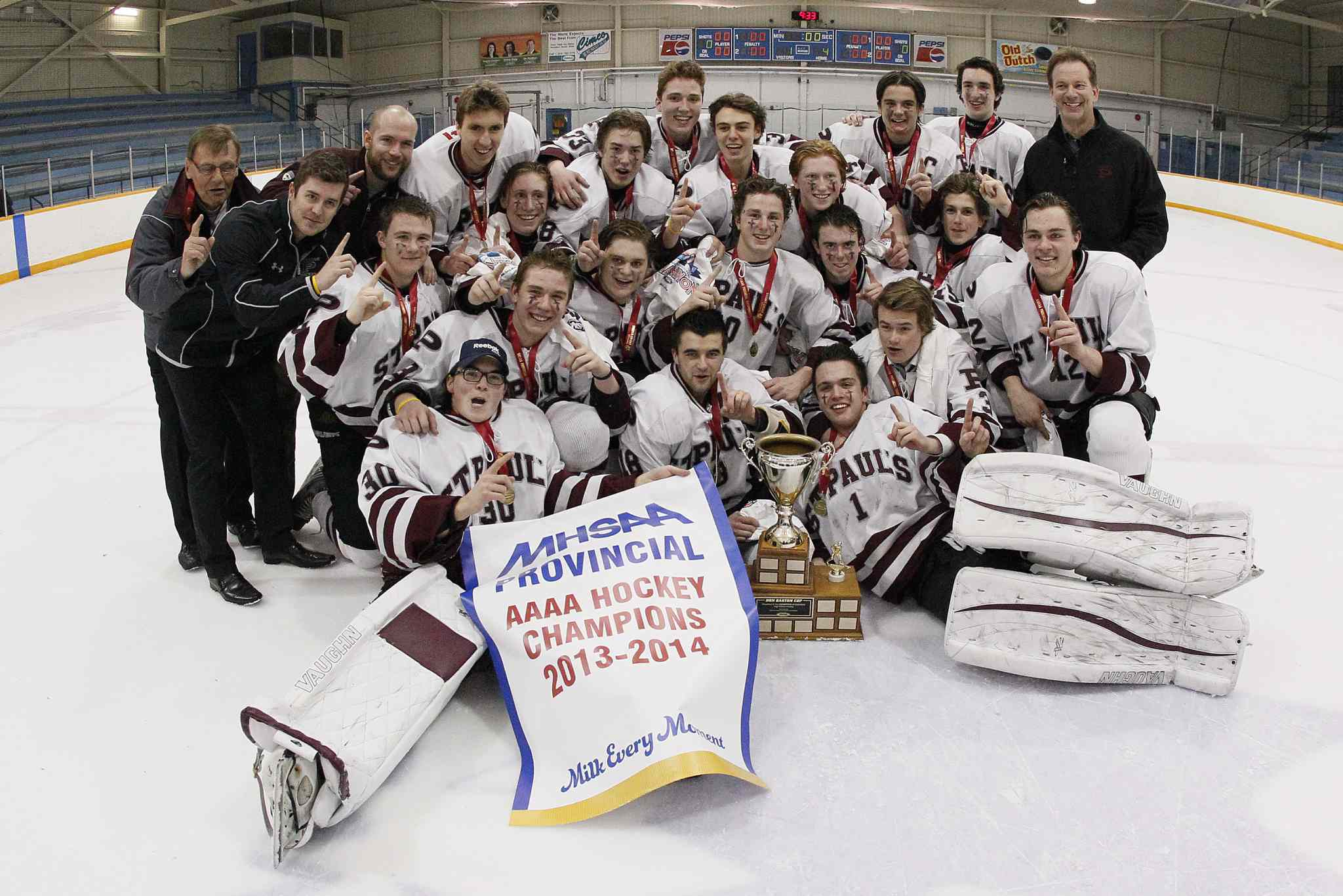 The provincial champion St. Paul's Crusaders hockey team pose for a trophy shot.