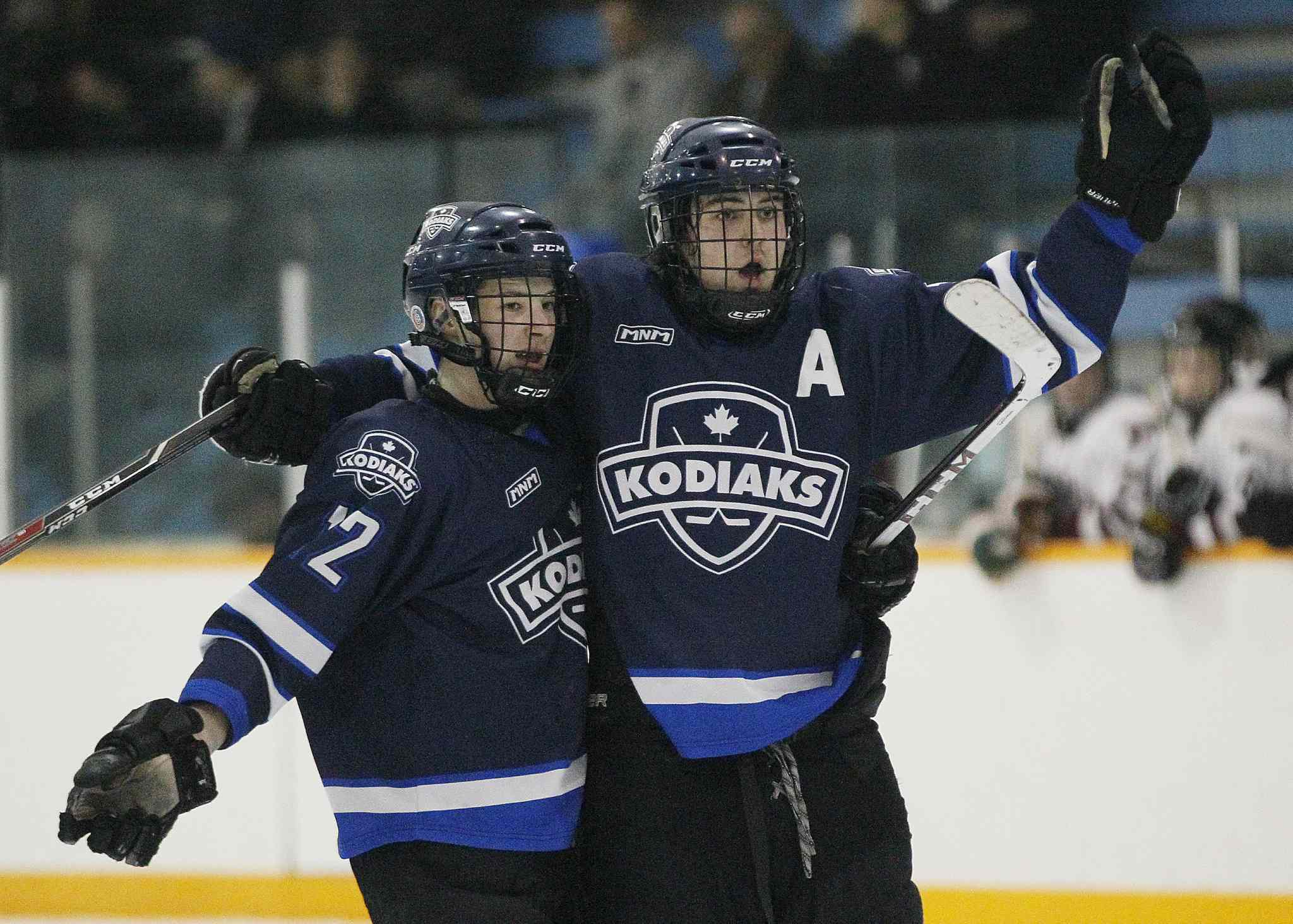 The River East Kodiaks Holden Band (left) and Tristan Beach celebrate Beach's goal against the St. Paul's Crusaders.