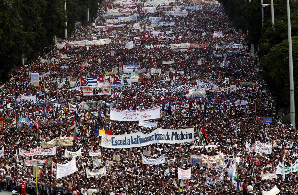 Thousands file through a street during a May Day march to Revolution Plaza in Havana, Cuba. Cuba marks each May Day not with protests but with massive marches organized by workplaces, schools and government.
