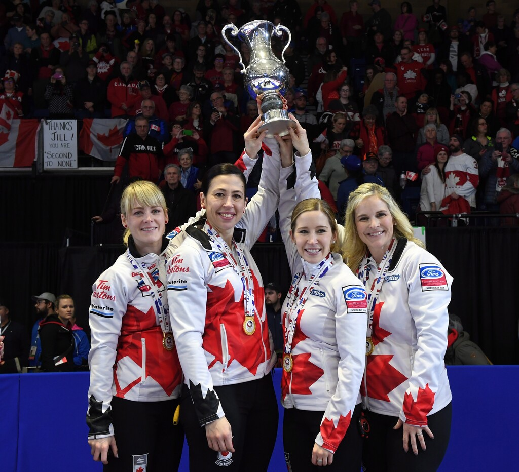 Dawn McEwen (from left), Jill Officer, Kaitlyn Lawes and Jennifer Jones after winning the World Women's Curling Championship in 2018. (Paul Chiasson / The Canadian Press)