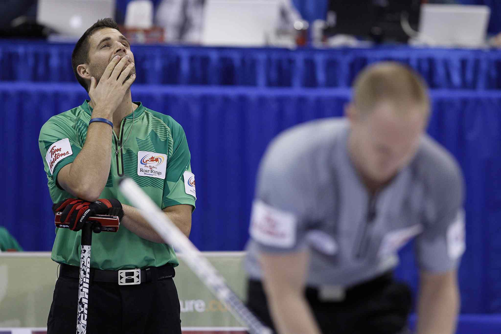 John Morris (left) looks up during the men's final against Brad Jacobs (right) at the 2013 Roar of the Rings Canadian Olympic curling trials in Winnipeg Sunday.