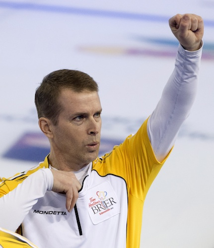 Manitoba skip Jeff Stoughton celebrates his win over Ontario Saturday night, which advances him to Sunday night's final of the Tim Hortons Brier in Edmonton.