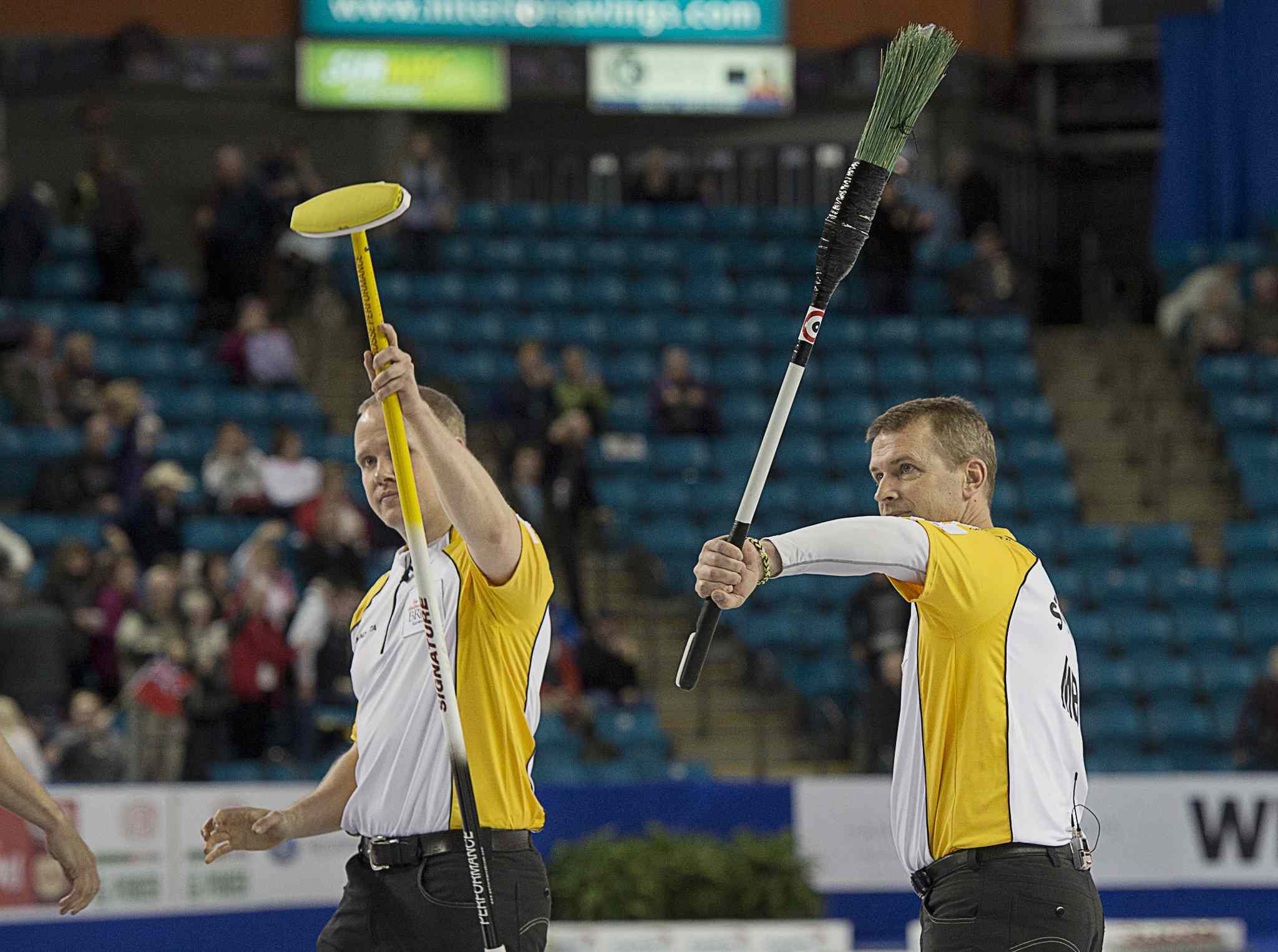 Jeff Stoughton (right) and lead Mark Nichols wave to the crowd almost as if to say goodbye after taking bronze at the Brier March 9.