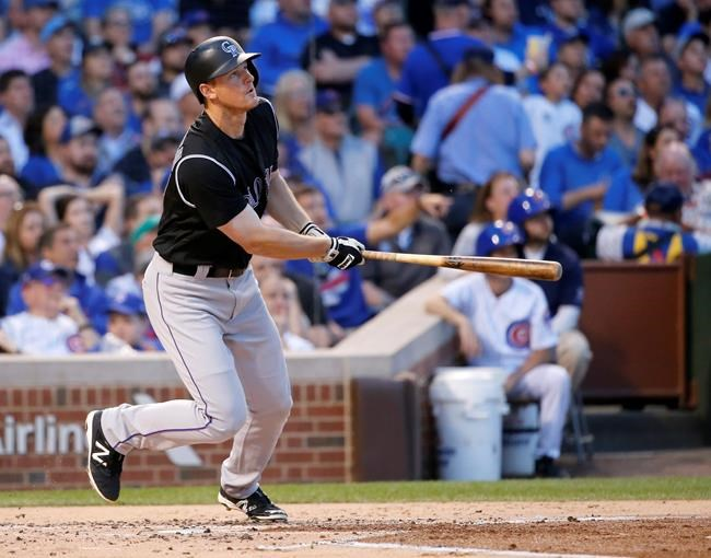 Blackmon, Hanigan power Rockies past Cubs