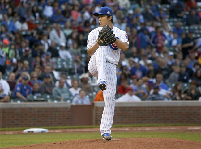 Chicago Cubs starting pitcher Tsuyoshi Wada delivers during the first inning of a baseball game against the Colorado Rockies Monday, July 28, 2014, in Chicago. (AP Photo/Charles Rex Arbogast)