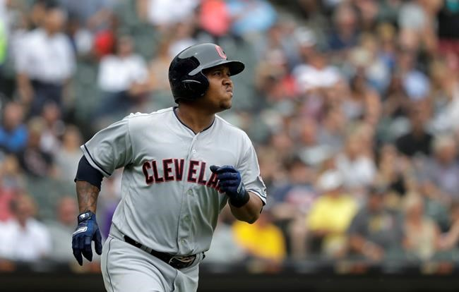 Cleveland Indians' Jose Ramirez watches his two-run home run off Chicago White Sox relief pitcher Chris Volstad during the seventh inning of a baseball game Thursday, June 14, 2018, in Chicago. Francisco Lindor also scored. (AP Photo/Charles Rex Arbogast)