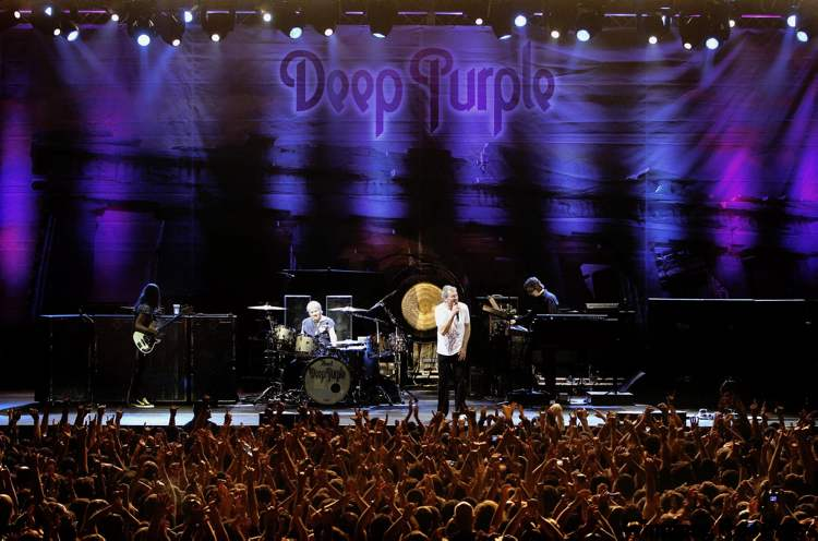 In this photo taken Sunday, May 8, 2011, Fans of British rock bad Deep Purple react during a concert in Nicosia, Cyprus.