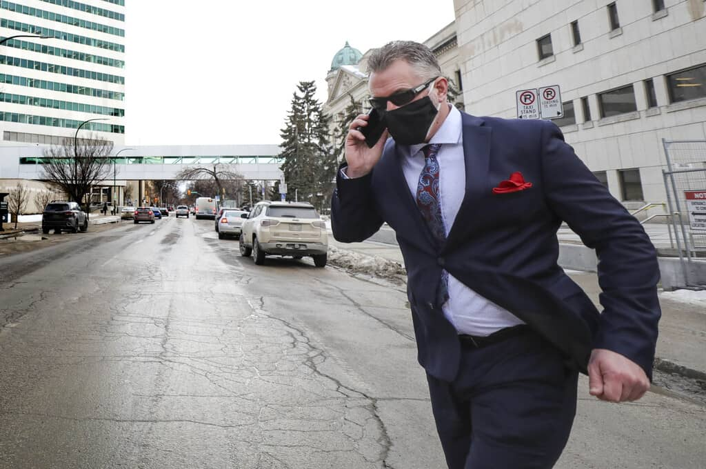 Patrol Sgt. Sean Cassidy crosses Kennedy Street after leaving the Law Courts Building after his hearing Monday. The Winnipeg Police Service veteran, who has spent more than two decades on the force, is currently on paid administrative leave.