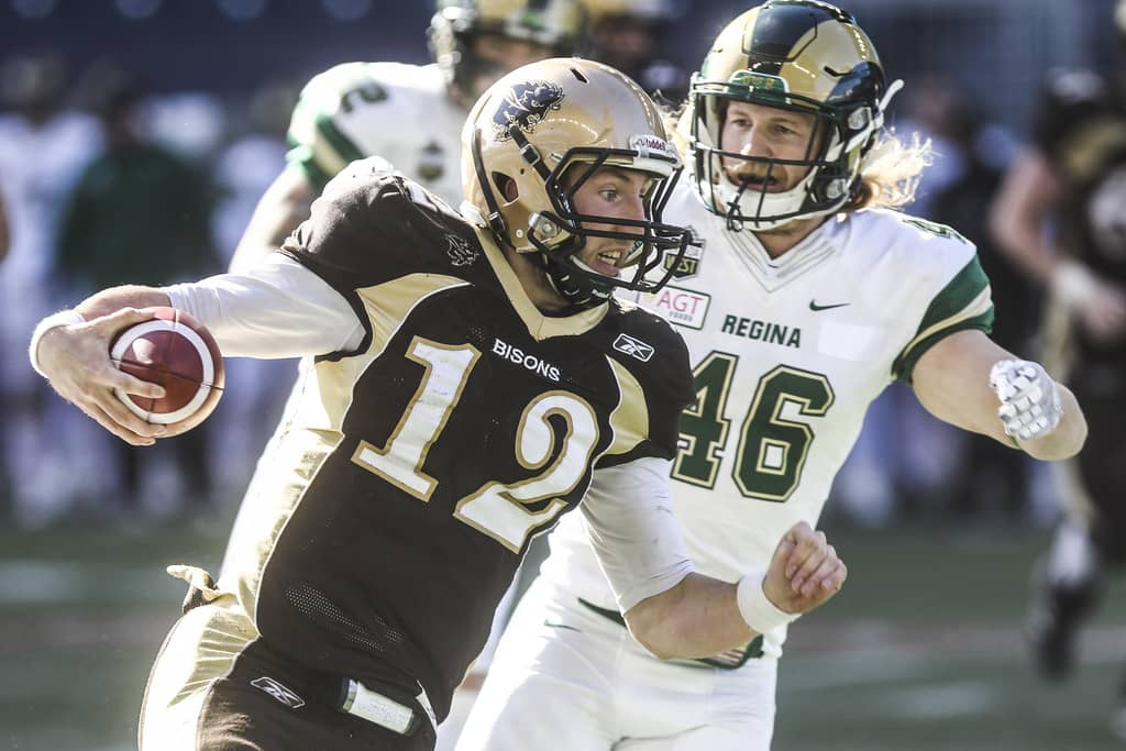 Manitoba Bisons' quarterback Des Catellier, left, is returning to the herd for another season.