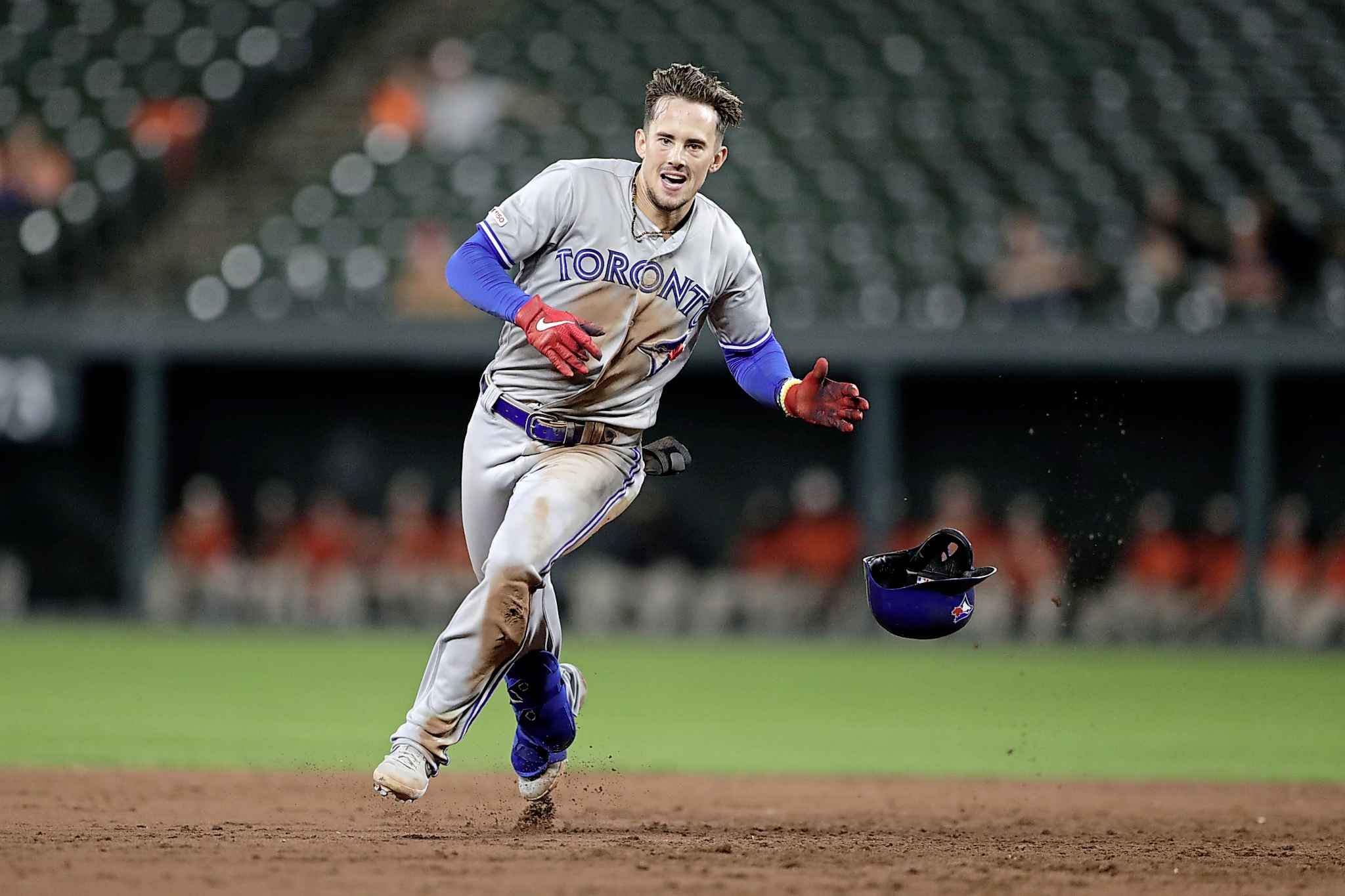 Players will run through walls to follow Cavan  Biggio. (Julio Cortez / Associated Press files)
