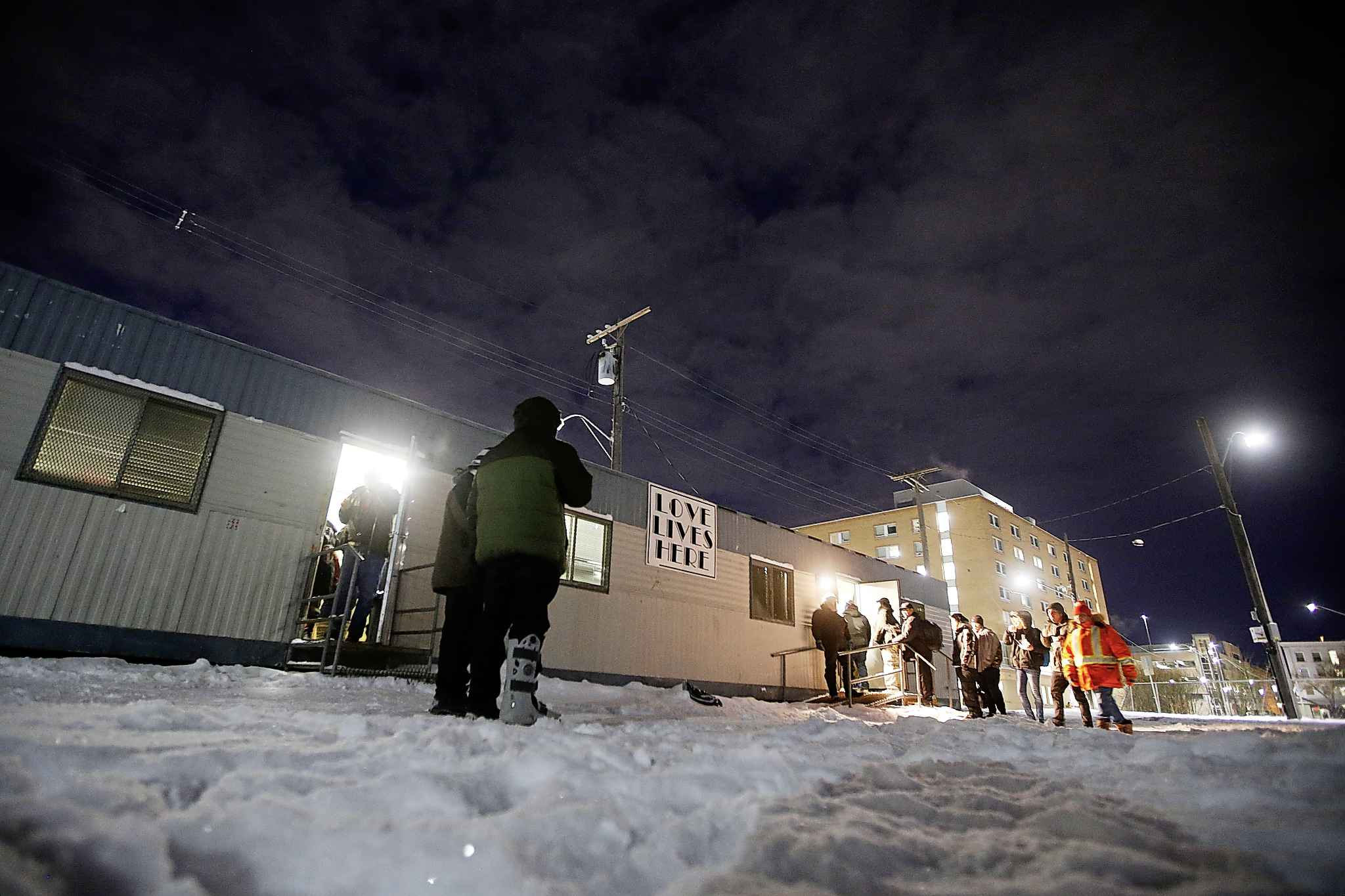 People begin to gather at the Love Lives Here mission.