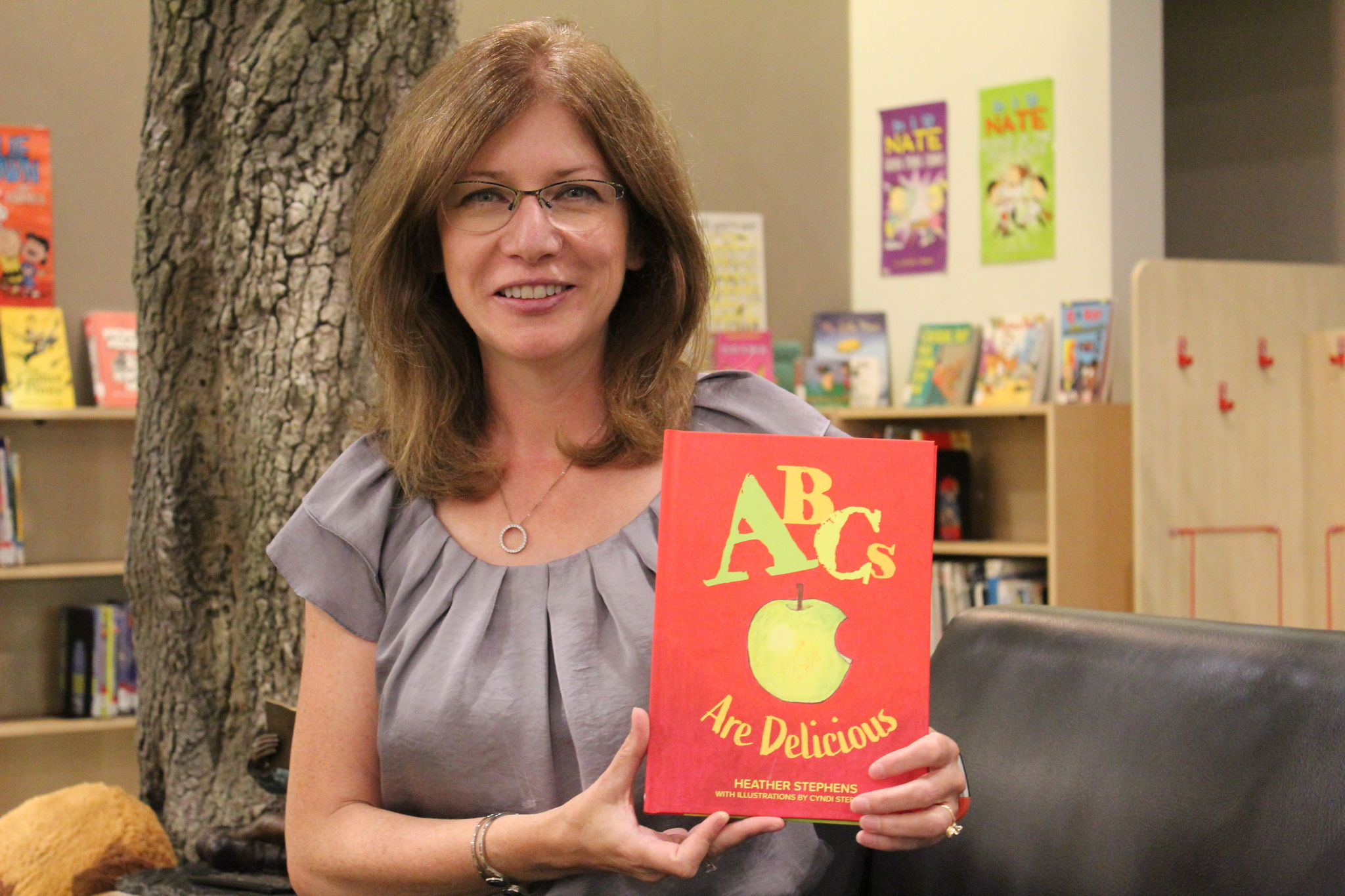 Heather Stephens displays her latest book, ABCs Are Delicious, in Steinbach's Jake Epp Library. She and illustrator Cyndi Stephens will launch the book this Sunday at 2 p.m. at McNally Robinson Booksellers.
