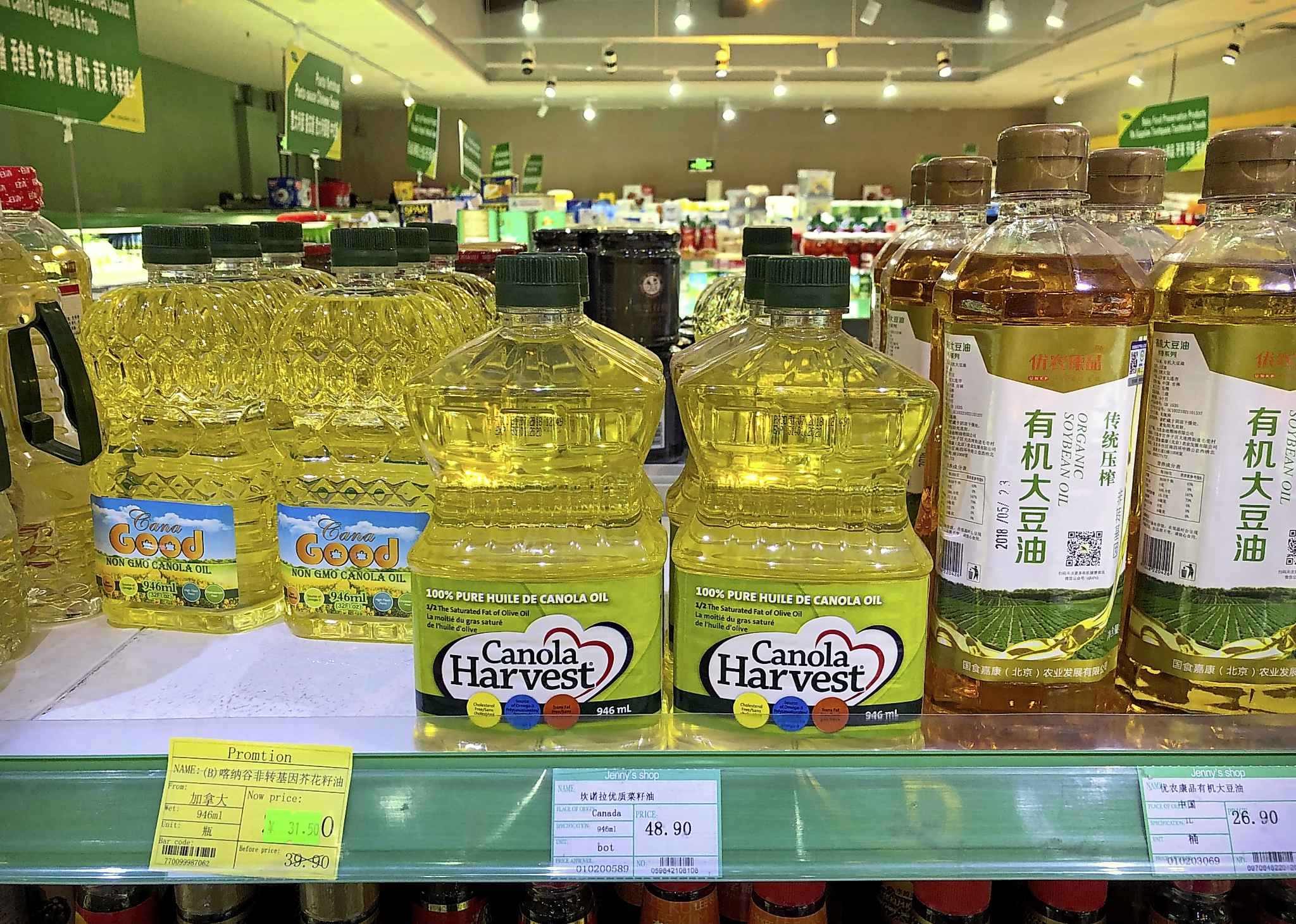 Bottles of Canola Harvest brand canola oil, manufactured by Richardson International, are seen on the shelf of a grocery store in Beijing.