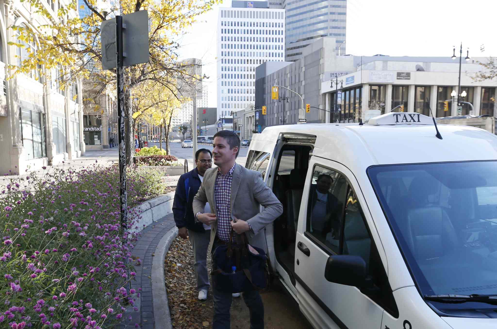 Uber Canada's Public Policy Manager Chris Schafer got a ride from taxi driver Nadeem Arain from the airport to the Winnipeg Chamber of Commerce office.