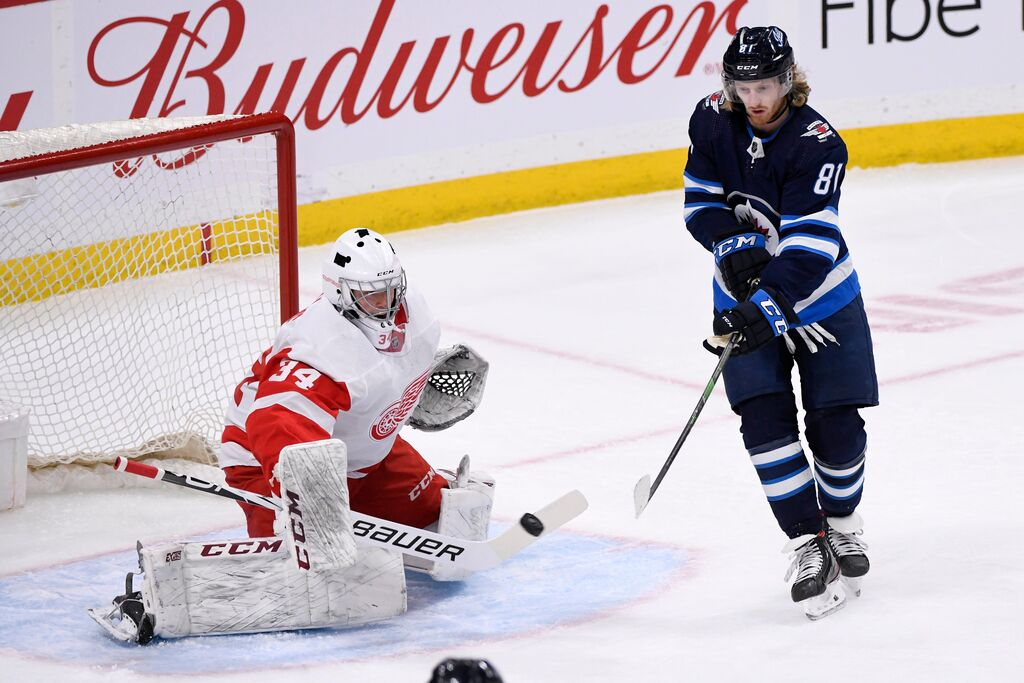 In 2019, Comrie was picked up on waivers by the Detroit Red Wings and, as fate would have it, would play his first game for the team against the Winnipeg Jets.