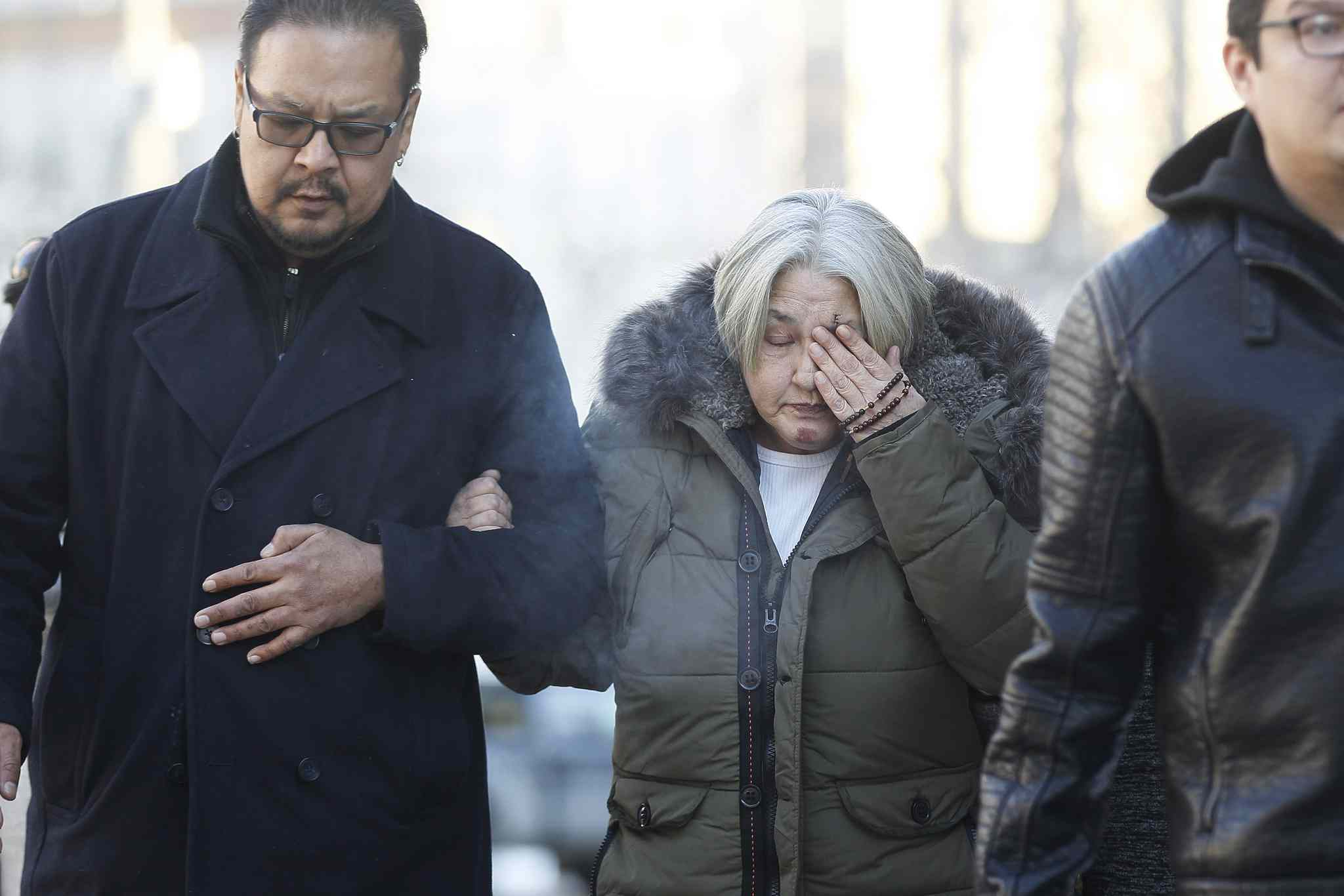 Thelma Favel, centre, Tina Fontaine's great-aunt and the woman who raised her, weeps as she enters the law courts in Winnipeg with Chief Kevin Hart and supporters the day the jury delivered a not-guilty verdict in the second degree murder trial of Raymond Cormier, Thursday, February 22, 2018. THE CANADIAN PRESS/John Woods