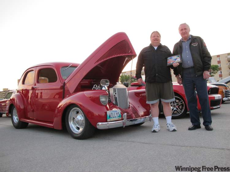 Gary Misko, left, with Fabulous 50's Ford Club of Manitoba president Albert Lannoo, was presented with the Cruiser of the Week award last Sunday at the Pony Corral cruise night.