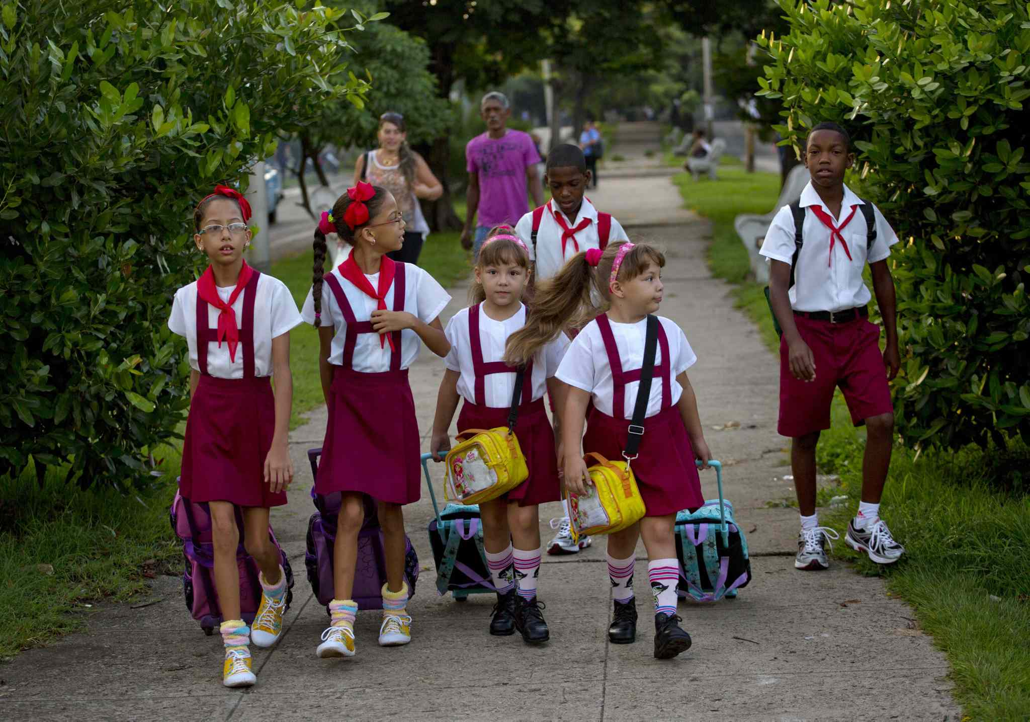 From left to right: nine-year-old twins Camila and Carla Rodriguez, six-year-old twins Asley and Aslen Velazquez, and 11-year-old twin brothers Arian and Adrian Cueto walk together to school in Havana, Cuba.