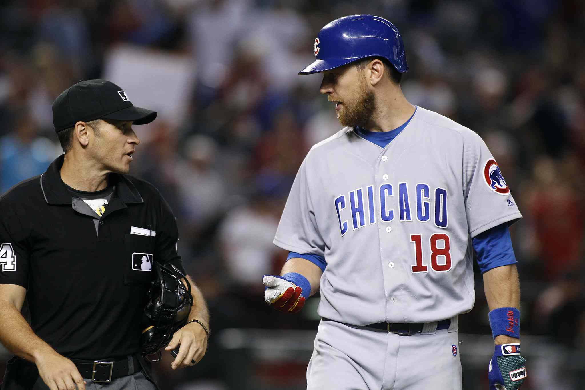 Chicago Cubs' Ben Zobrist (18) talks with home plate umpire Mark Wegner after being called out on strikes to end the baseball game against the Arizona Diamondbacks on Saturday, Aug. 12, 2017, in Phoenix. The Diamondbacks defeated the Cubs 6-2. (AP Photo/Ralph Freso)