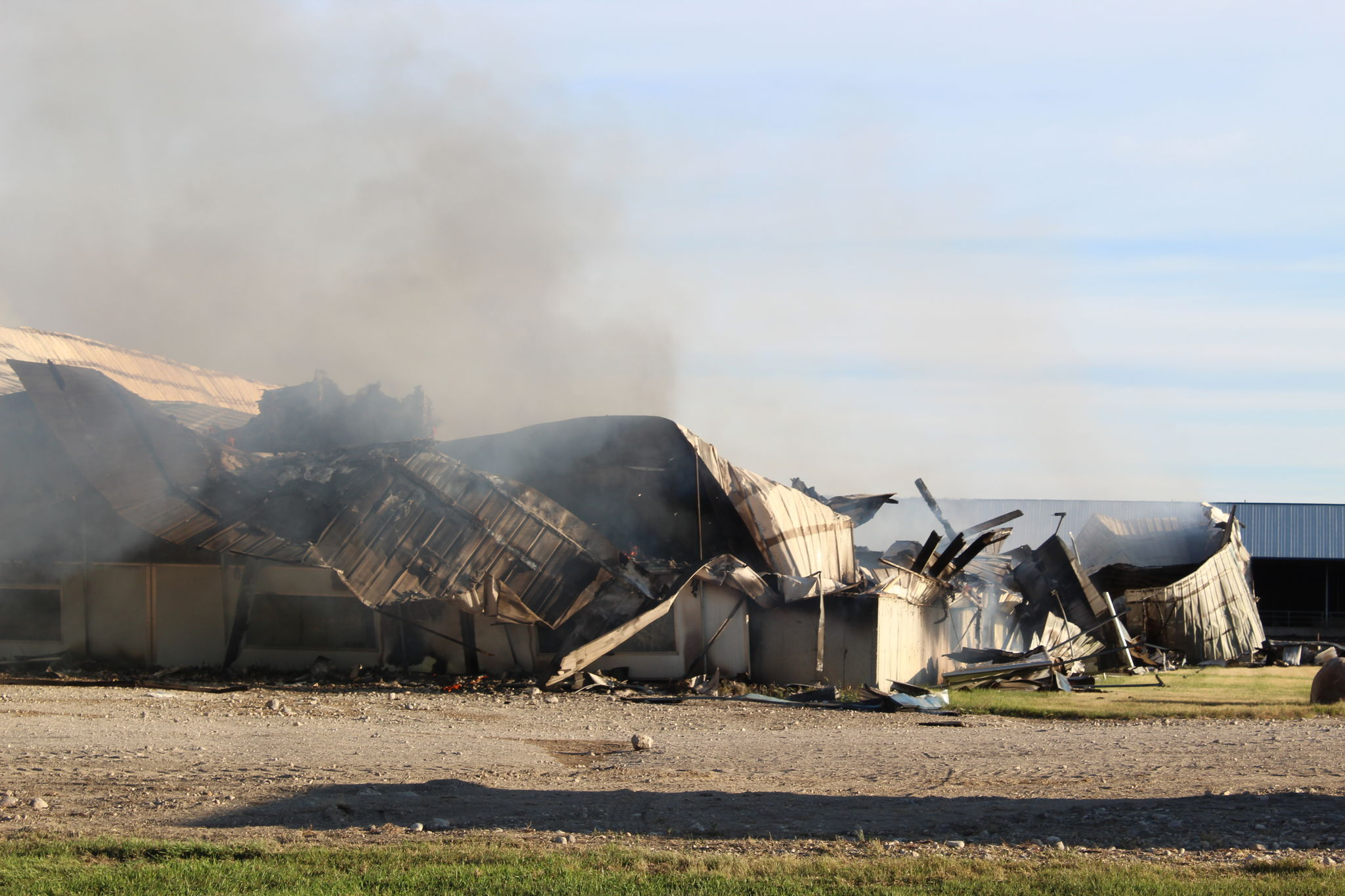 Hours later, fire crews were still working to extinguish the smoldering remains of the barn. A 911 call reported the blaze at Pennwood Dairy at 4:42 a.m. on Monday morning.