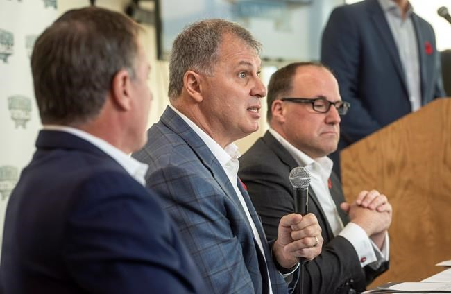 CFL commissioner, Randy Ambrosie, centre, speaks to reporters during a press conference with Maritime Football Limited Partnership founding partners Bruce Bowser, left, and Anthony LeBlanc in Halifax on Wednesday, November 7, 2018. THE CANADIAN PRESS/Darren Calabrese