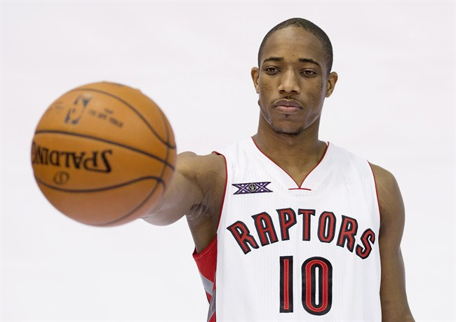 Toronto Raptors' DeMar DeRozan poses for photos during the team's media day at the Air Canada Centre in Toronto on Monday, September 29, 2014. DeRozan spent the off-season working on his left hand — by writing out the alphabet with his daughter Kiara. THE CANADIAN PRESS/Darren Calabrese