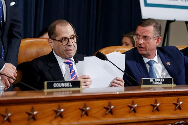 House Judiciary Committee Chairman Rep. Jerrold Nadler, D-N.Y., left, gathers his papers as ranking member Rep. Doug Collins, R-Ga., talks after the House Judiciary Committee hearing on the constitutional grounds for the impeachment of President Donald Trump, on Capitol Hill in Washington, Wednesday, Dec. 4, 2019 (AP Photo/Alex Brandon)