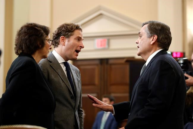 Harvard Law School professor Noah Feldman, Stanford Law School professor Pamela Karlan and George Washington University Law School professor Jonathan Turley talk during a break in a hearing before the House Judiciary Committee on the constitutional grounds for the impeachment of President Donald Trump, on Capitol Hill in Washington, Wednesday, Dec. 4, 2019. (AP Photo/Alex Brandon)