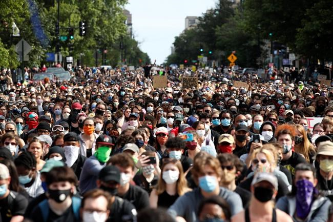 Demonstrators march as they protest the death of George Floyd, Tuesday, June 2, 2020, in Washington. Floyd died after being restrained by Minneapolis police officers. (AP Photo/Alex Brandon)