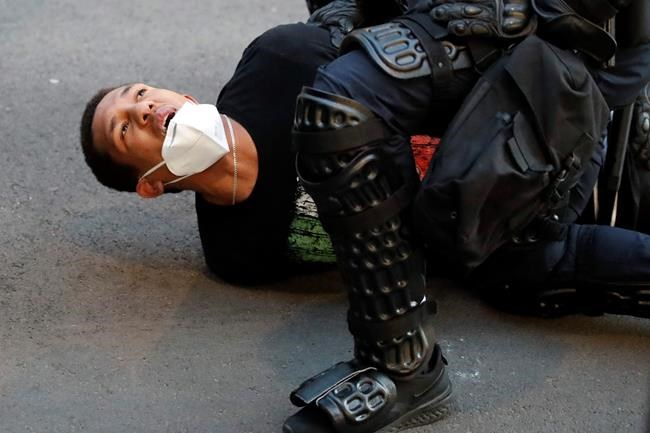 A demonstrator is taken into custody by police after a curfew took effect during a protest over the death of George Floyd, Monday, June 1, 2020, near the White House in Washington. Floyd died after being restrained by Minneapolis police officers. (AP Photo/Alex Brandon)