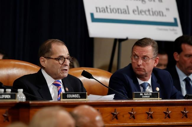 House Judiciary Committee ranking member Rep. Doug Collins, R-Ga., looks over to Chairman Rep. Jerrold Nadler, D-N.Y., left, as he speaks during a hearing before the House Judiciary Committee on the constitutional grounds for the impeachment of President Donald Trump, on Capitol Hill in Washington, Wednesday, Dec. 4, 2019. Republican counsel Paul Taylor, right. (AP Photo/Andrew Harnik)