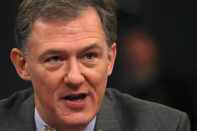 Career Foreign Service officer George Kent testifies before the House Intelligence Committee on Capitol Hill in Washington, Wednesday, Nov. 13, 2019, during the first public impeachment hearing of President Donald Trump's efforts to tie U.S. aid for Ukraine to investigations of his political opponents. (AP Photo/Andrew Harnik)